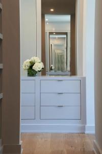 Closet with Gray Built In Dresser - Transitional - Closet