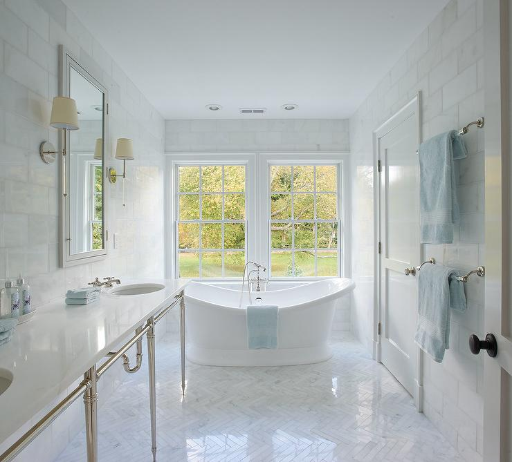 White Bathroom with Blue Accents and Marble Herringbone
