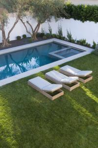 In Ground Pool with Hot Tub Flanked by Steps ...