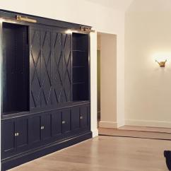 Hiding Tv In Living Room Glass Table Navy Blue Cabinets With Diamond Pattern Sliding Doors Concealing