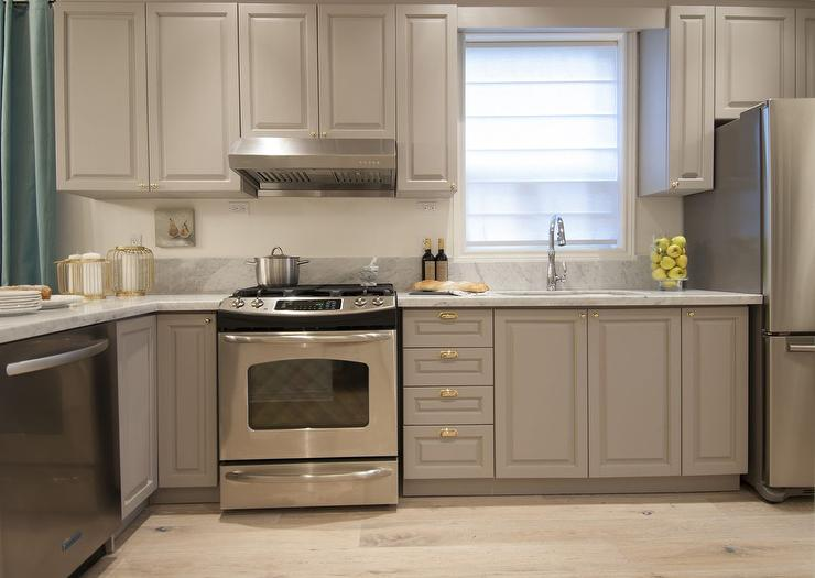 Small Kitchen with Gray Cabinets and Shiny Brass Hardware