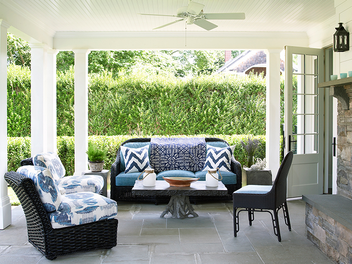 Gray Wicker Outdoor Sofa And Chairs With Teal Pillows