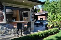 Pool House Kitchen with Bar - Transitional - Deck/patio