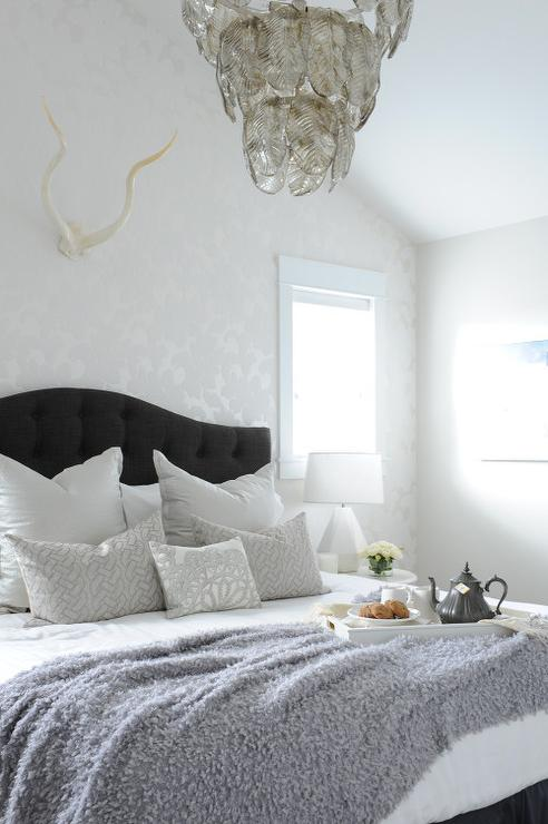 silver bedroom with black tufted