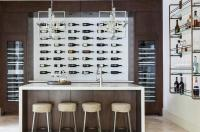 Contemporary Wine Cellar with Wall Wine Bottle Display ...