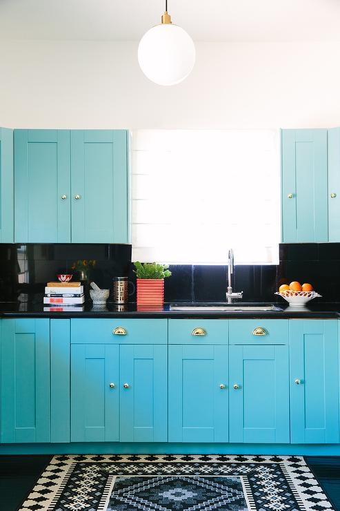 Turquoise Blue Kitchen with Black Countertops and