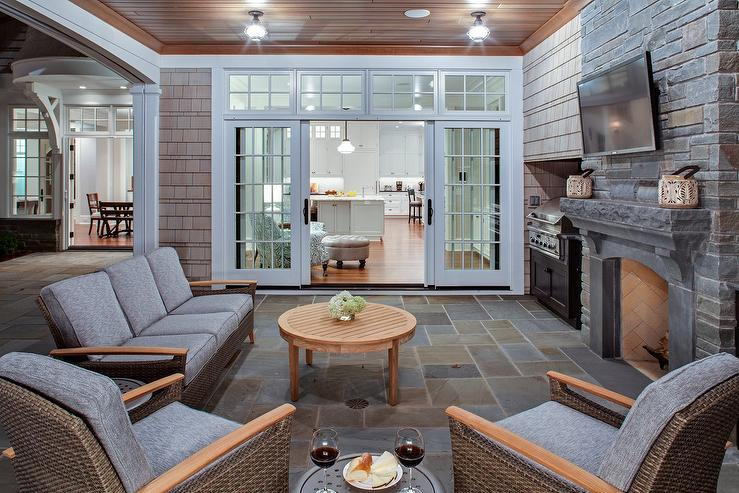 white slipcovered chair electric recliner motors parts covered patio with fireplace - transitional deck/patio thompson custom homes