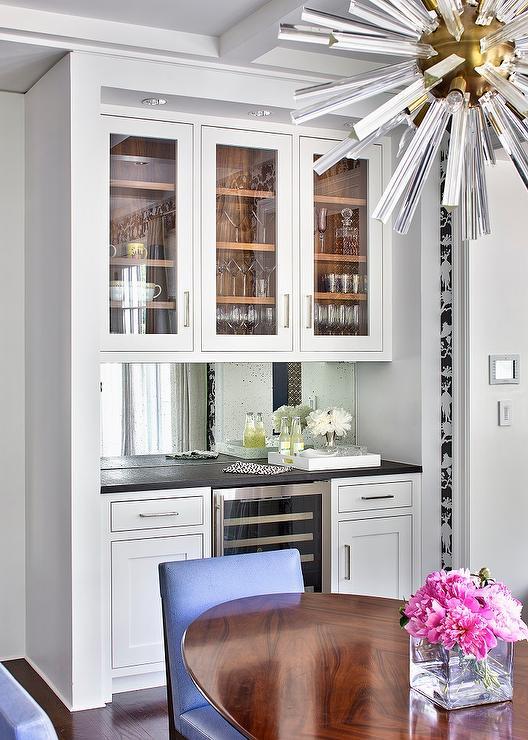 Kitchen nook with Bar Cabinets and Mirror Backsplash