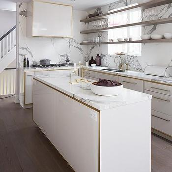 gold kitchen decorative wall art white and design ideas cabinets with gray floating shelves in front of windows