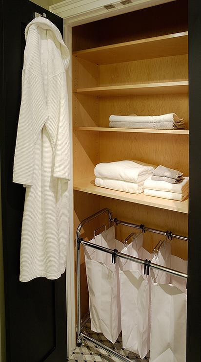 small bathroom closet with laundry sorters - transitional - bathroom
