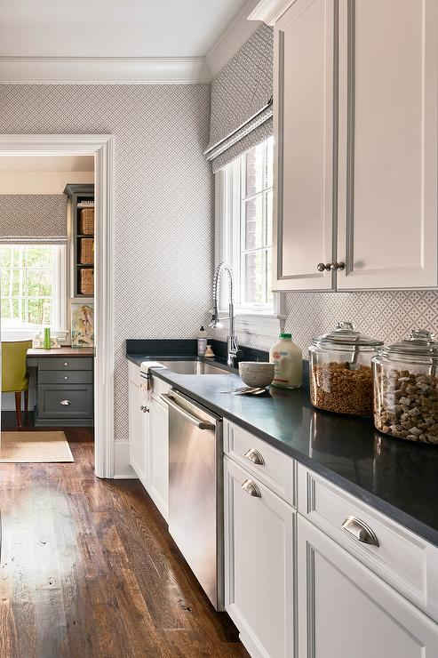 Long KItchen Pantry with White Cabinets and Black Quartz