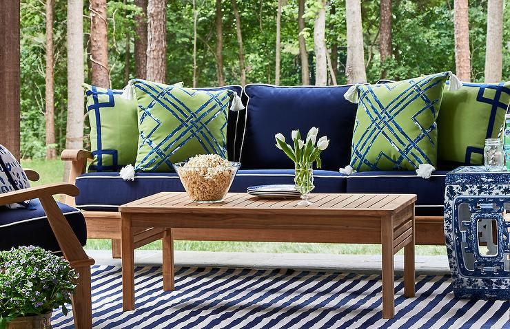 green cushions living room montana 5th wheel front teak outdoor sofa with blue and pillows