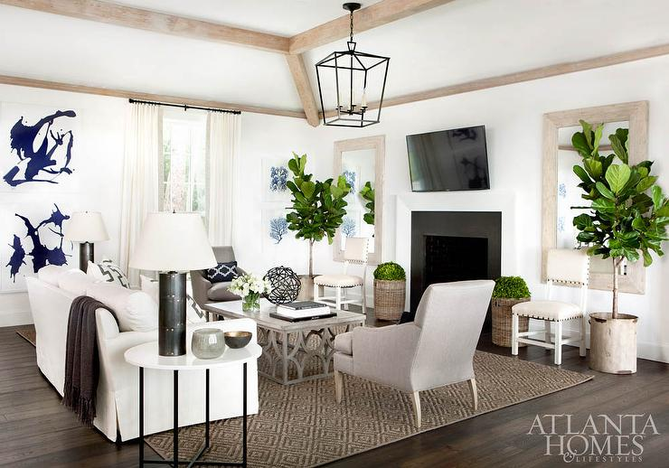 White and Gray Living Room with Tilted Flat Panel TV Over