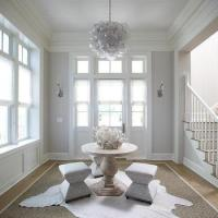 Round Center of Foyer Table with White Cowhide Rugs ...