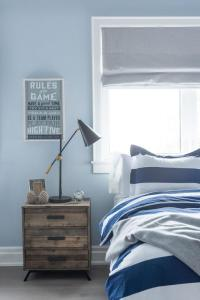 Blue and Gray Boy Bedroom with Bed Under Window ...