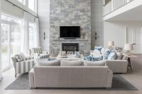 Blue and Gray Living Room with a Two Story Stone Fireplace ...