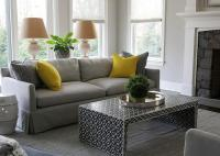 grey sofa with cushions