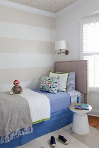 White and Beige Striped Kids Bedroom with Scattered Gold