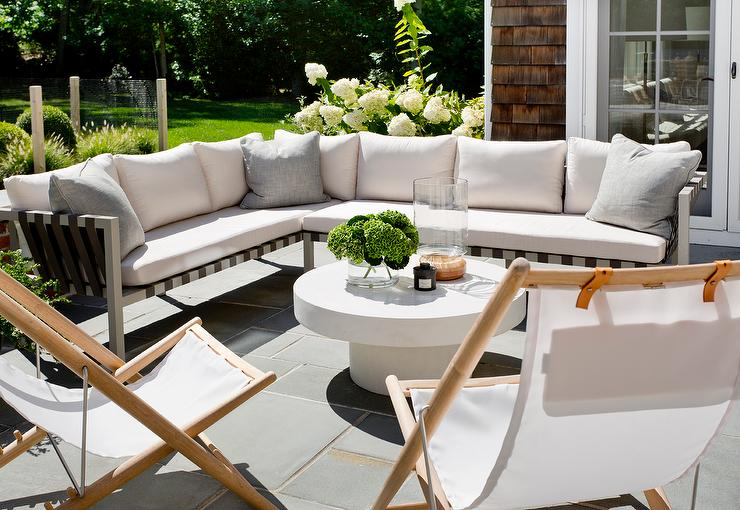 Outdoor Sectional With Folding Chairs And White Pedestal