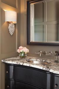 Taupe Powder Room with Black Washstand and Granite ...