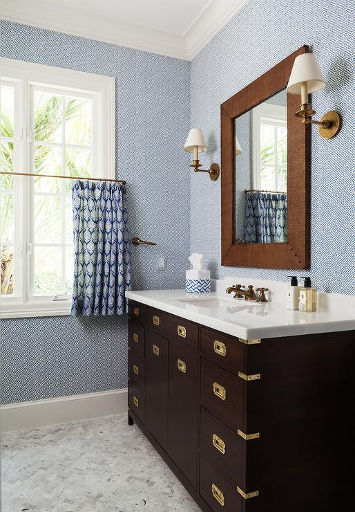 brown and blue boys bathroom features walls clad in blue geometric wallpaper quadrille china seas java grande lined with a brown burlap beveled mirror