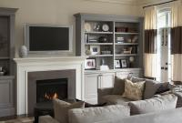 Gray Sectional with Gray Built In Shelves and Cabinets ...
