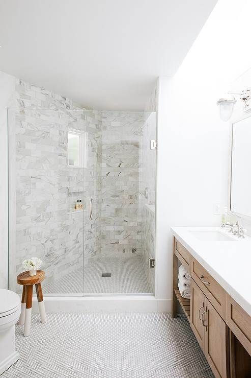 shower with white penny tile floor