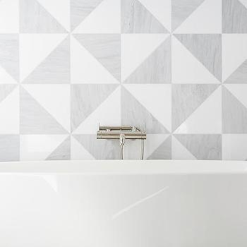 and gray triangle backsplash tiles