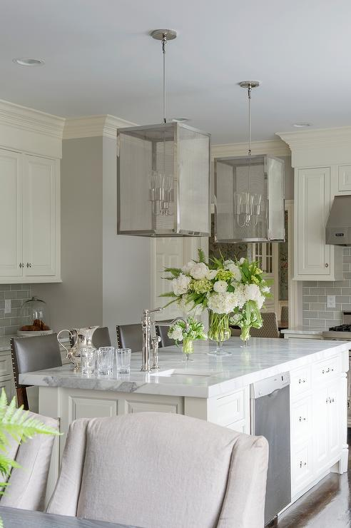 Ivory Kitchen Island with Nickel and Mesh Lanterns