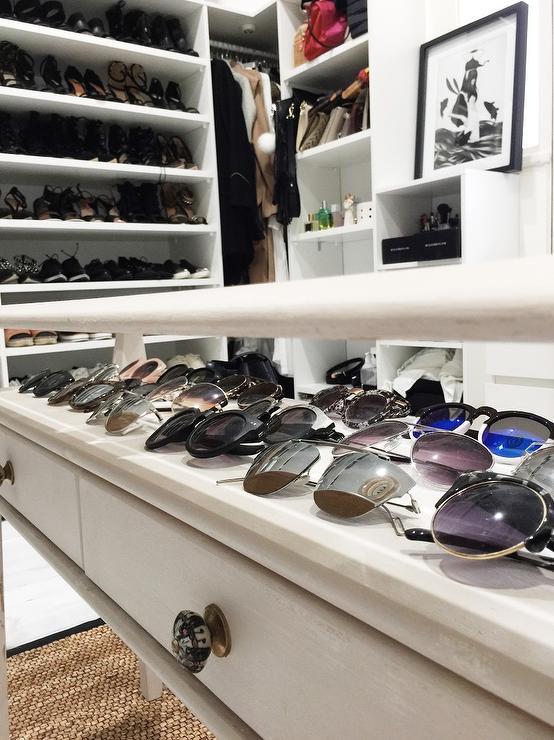 Closet with Glass Top Closet Table Showcasing Sunglasses