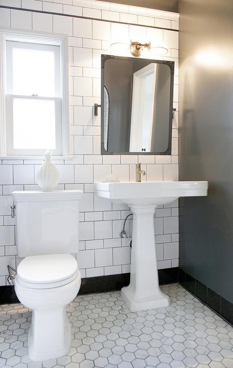 White Pedestal Sink with Aged Brass Rivet Mirror