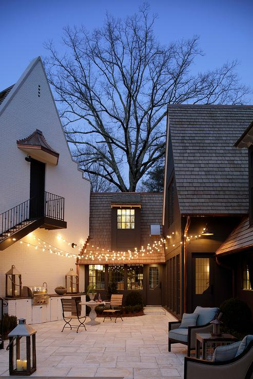 Patio with Fairy Lights and Outdoor Kitchen  Transitional