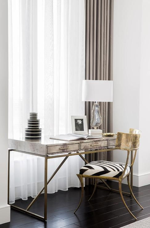 Brass Base Desk with Gray Agate Lamp in Front of Window