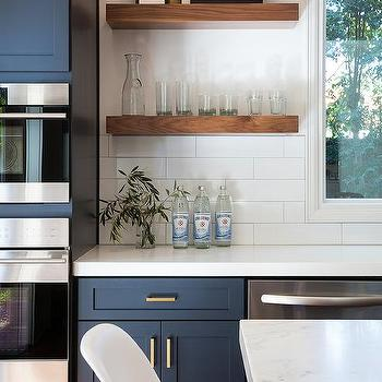 alternatives to kitchen cabinets prep sink navy blue with brushed brass pulls and ...