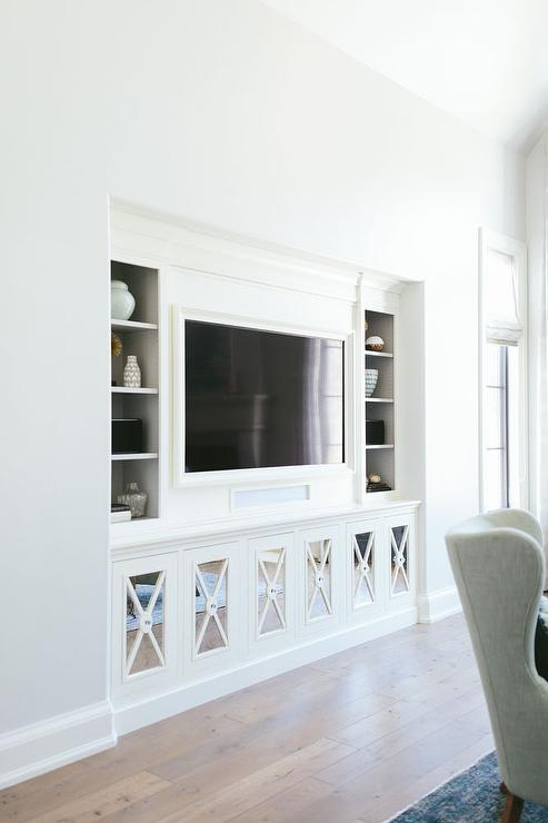 living room cabinets built in small with wood stove design ideas chic nook is filled a flat panel tv niche flanked by shelving as well mirrored x front