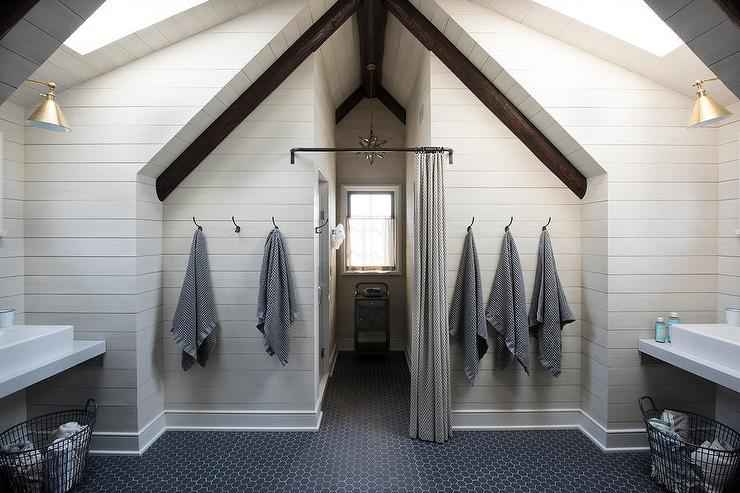 shared attic kids bathroom with vaulted