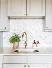 Gray Cabinets with Marble Chevron Tile Backsplash ...