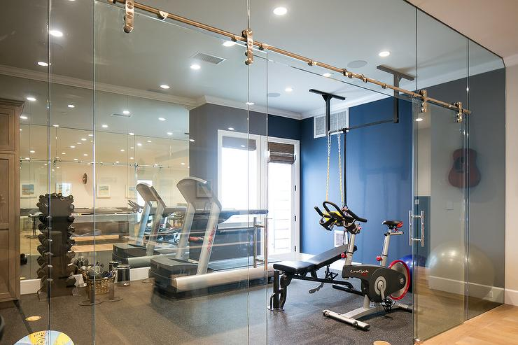 Home Gym with Glass Sliding Door On Rails