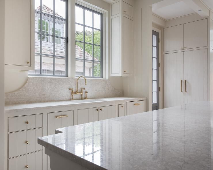 White Shiplap Kitchen Cabinets With Aged BRass Oval Knobs Cottage Kitchen