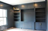 Gray Home Office with Gray Built Ins and Brass Swing Arm