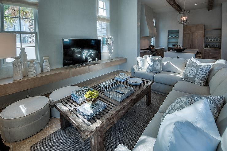 Light Gray Linen Plush Sectional Facing A Floating Tv