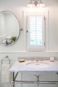 Bathroom Window Dressed in Plantation Shutters Over Vanity ...