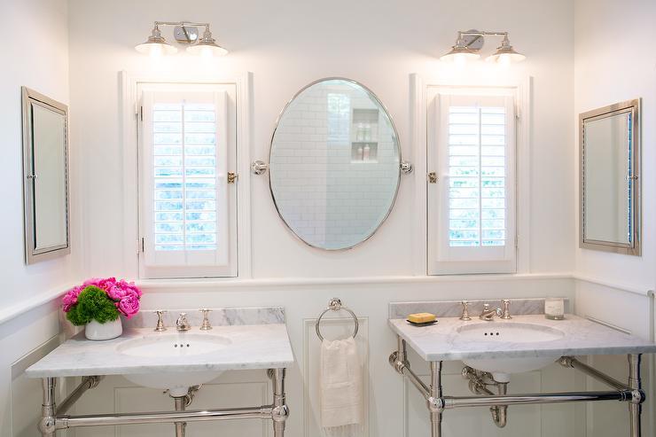 Bathroom Window Dressed in Plantation Shutters Over Vanity