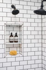 Shower with White Subway Tiles and Black Grout ...
