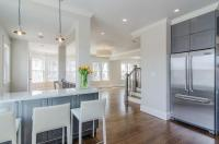 Gray Kitchen Peninsula with White leather Counter Stools ...