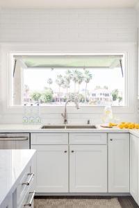 Tilt Out Window Over Kitchen Sink - Transitional - Kitchen