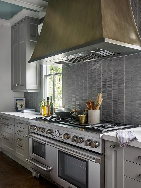 Gray Kitchen Cabinets with Silver Backsplash Tiles