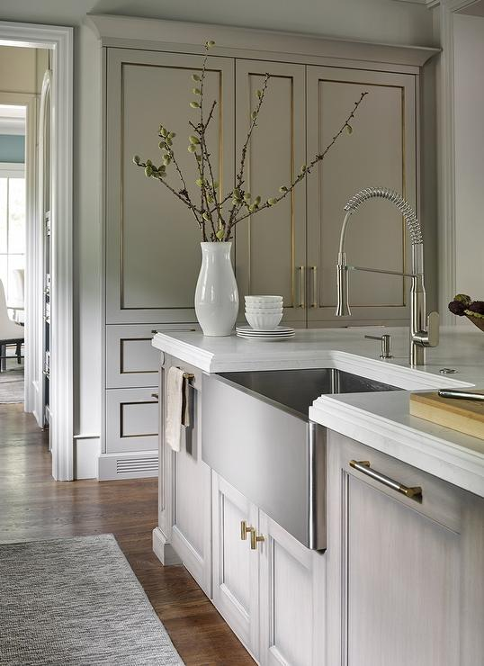 Gray Wash Kitchen Island with Nickel and Brass Pulls and Stainless Steel Apron Sink
