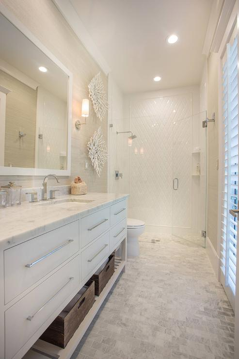 Long Beach Style Bathroom with Carrera Marble Brick Tile