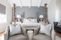 Gray Linen Bedroom Chairs with Blue Pillows Placed at Foot ...